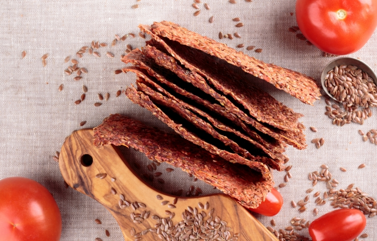 Vegetables crispbread crackers with flax seeds and tomatoes. Healthy food.