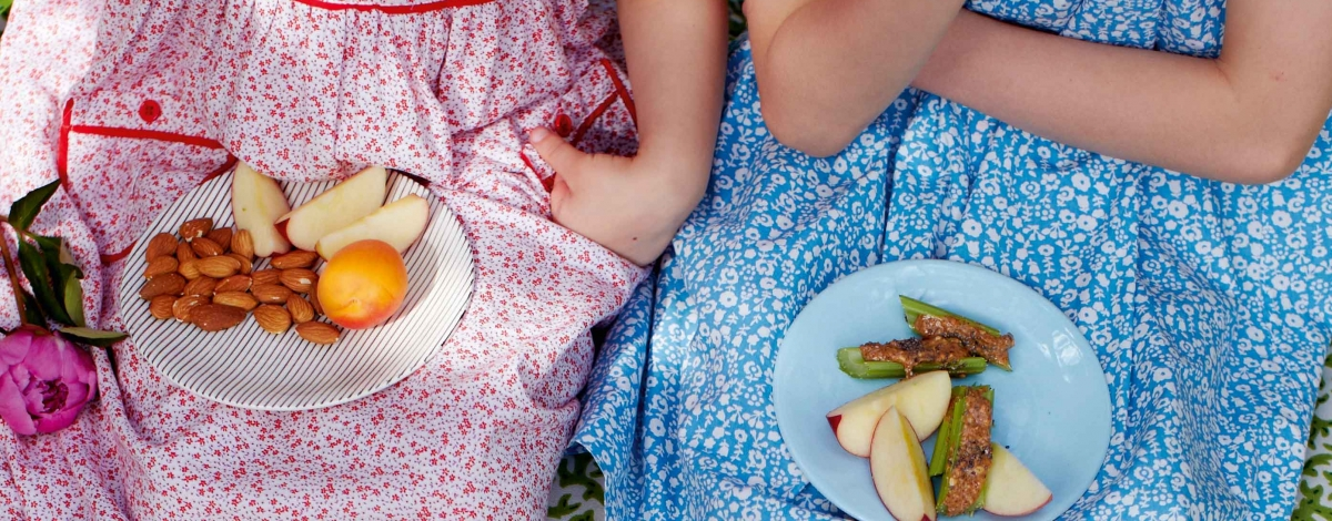 Children eating nuts and fruit