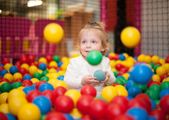 Baby girl in ball pool